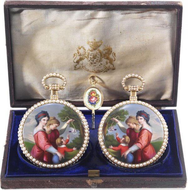 The Royal Presentation Mirror-Image Pair, i.e. a pair of gold and painted enamel pocket watches, set with pearls, dating from the beginning of the 19th century © Antiquorum